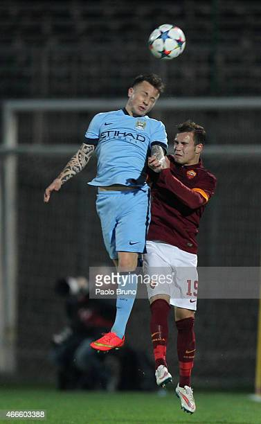 Jose' Tasende of Manchester City competes for the ball with Lorenzo Di Livio of AS Roma during the UEFA Youth League Quarter Final match between AS...
