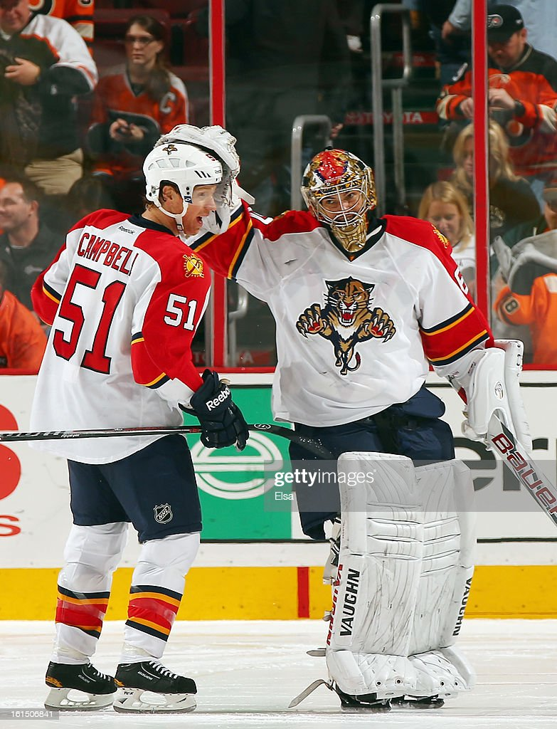 Jose Theodore #60 and Brian Campbell #51 of the Florida Panthers celebrate the win over the Philadelphia Flyers on February 5, 2013 at the Wells Fargo Center in Philadelphia, Pennsylvania. The Florida Panthers defeated the Philadelphia Flyers 3-2 in an overtime shootout.