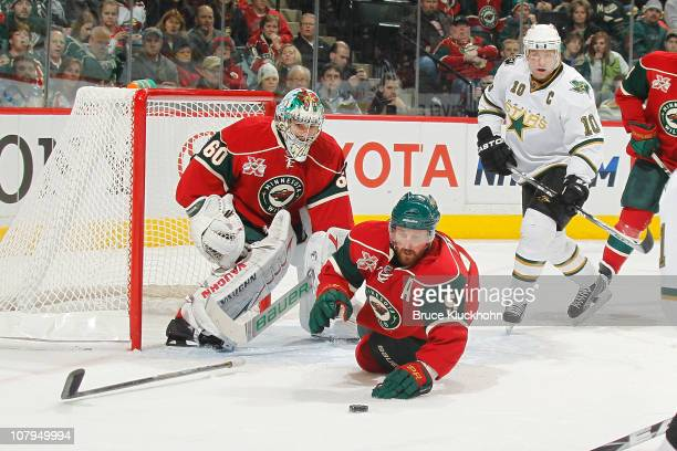 Jose Theodore and Greg Zanon of the Minnesota Wild defend their goal against Brenden Morrow of the Dallas Stars during the game at Xcel Energy Center...