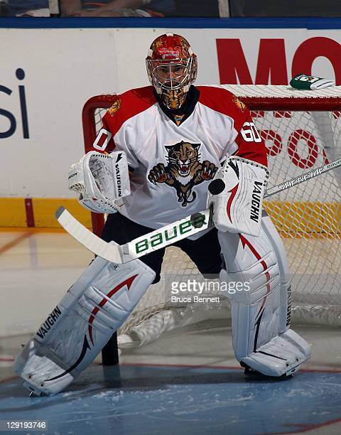 Jose Theodore of the Florida Panthers defends the net against the New York Islanders at the Nassau Veterans Memorial Coliseum on October 8 2011 in...