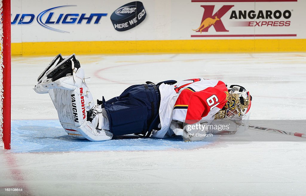 Jose Theodore #60 of the Florida Panthers falls to the ice in pain during an NHL game against the Carolina Hurricanes on March 2, 2013 at PNC Arena in Raleigh, North Carolina.