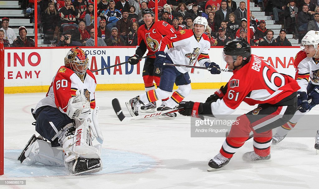 <a gi-track='captionPersonalityLinkClicked' href=/galleries/search?phrase=Jose+Theodore&family=editorial&specificpeople=202011 ng-click='$event.stopPropagation()'>Jose Theodore</a> #60 of the Florida Panthers makes a glove save against Andre Benoit #61 of the Ottawa Senators on January 21, 2013 at Scotiabank Place in Ottawa, Ontario, Canada.