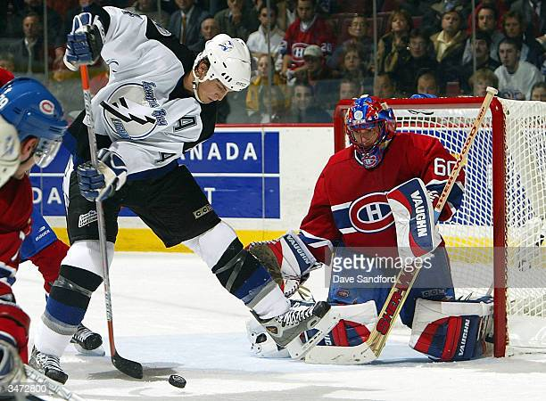 Jose Theodore of the Montreal Canadiens is beat on this tipped shot by Vincent Lecavalier of the Tampa Bay Lightning for the game tying goal with...