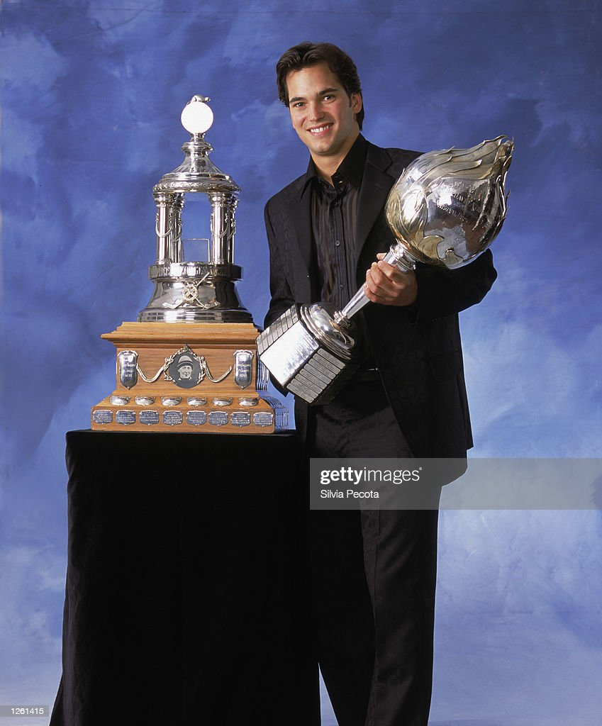Jose Theodore of the Montreal Canadiens poses for a studio portrait with the Hart Memorial Trophy awarded to the 'Most Valuable Player' and the...