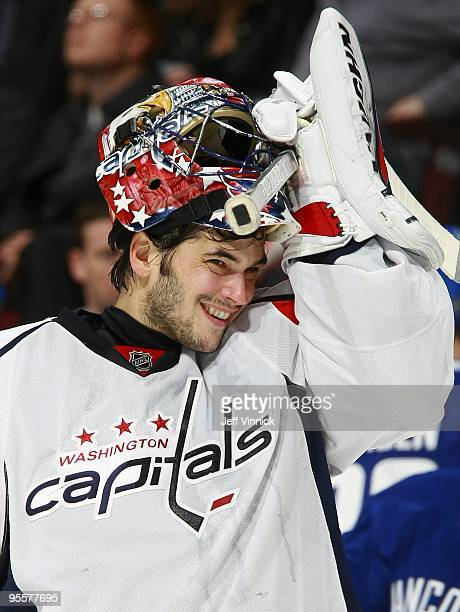 Jose Theodore of the Washington Capitals looks on from his crease during their game against the Vancouver Canucks at General Motors Place on December...