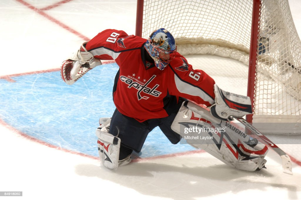 Jose Theodore of the Washington Capitals makes a save during a NHL hockey game against the Montreal Canadiens on February 18 2009 at the Verizon...