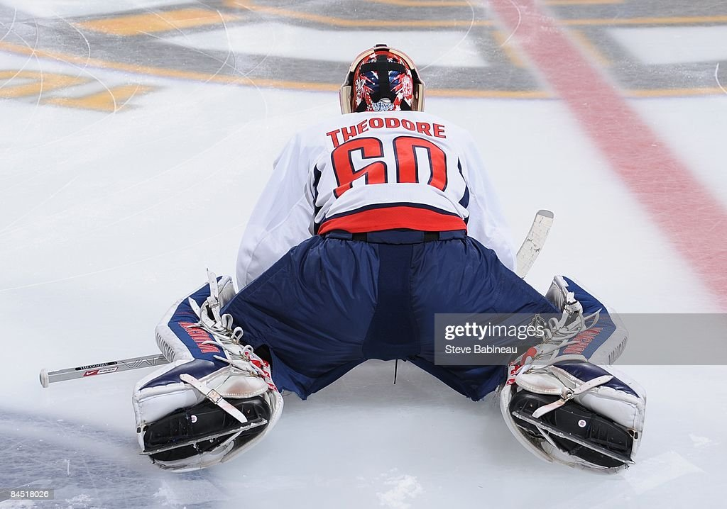 Jose Theodore of the Washington Capitals stretches during warmup against the Boston Bruins at the TD Banknorth Garden on January 27 2009 in Boston...
