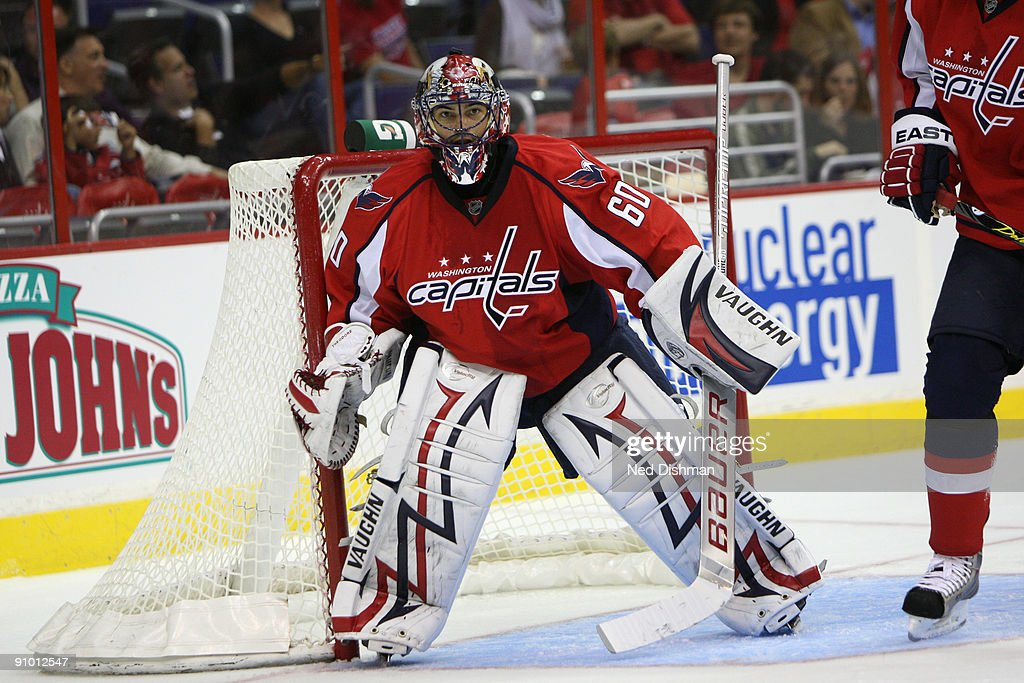 Jose Theodore #60 of the Washington Capitals watches the puck against the Buffalo Sabres during an NHL preseason hockey game on September 21, 2009 at the Verizon Center in Washington, DC..