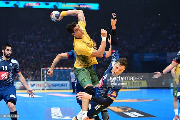 Jose Toledo of Brasil and Kentin Mahe of France during the IHF Men's World Championship match between France and Brazil Preliminary round Group A at...
