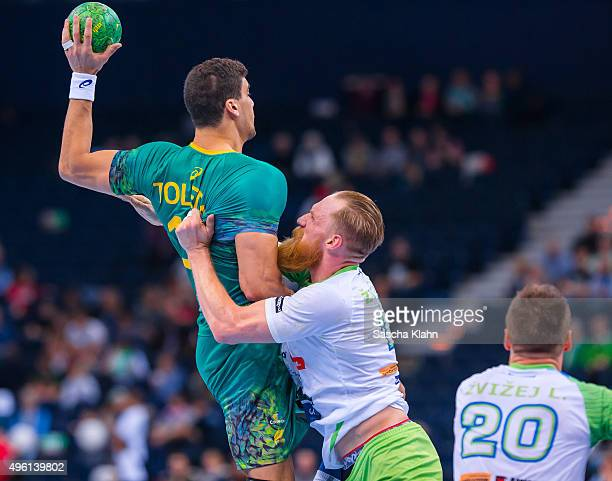 Jose Toledo of Brasil challenges Miha Zvizej of Slovenia during the Men's Handball Supercup between Brasil and Slovenia at Barclaycard Arena on...
