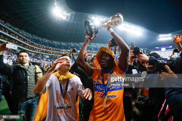 Jose Torres and Enner Valencia of Tigres lift the trophy to celebrate after winning the second leg of the Torneo Apertura 2017 Liga MX final between...