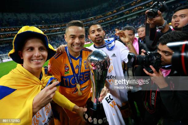 Jose Torres Juninho and Javier Aquino of Tigres celebrate with the trophy after winning the second leg of the Torneo Apertura 2017 Liga MX final...