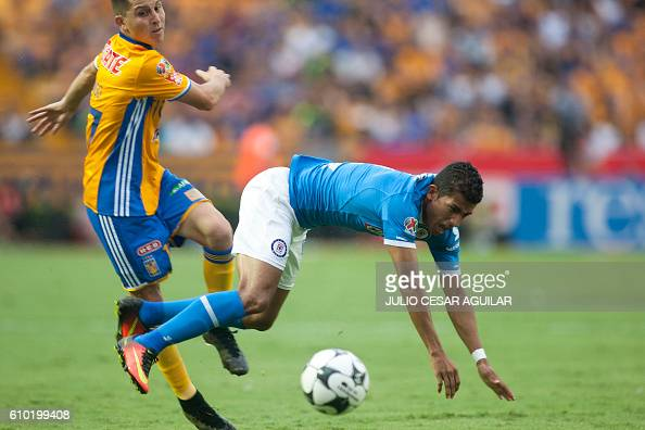 Jose Torres of Tigres vies for the ball with Joao Rojas of Cruz Azul during their Mexican Apertura 2016 tournament football match at the...