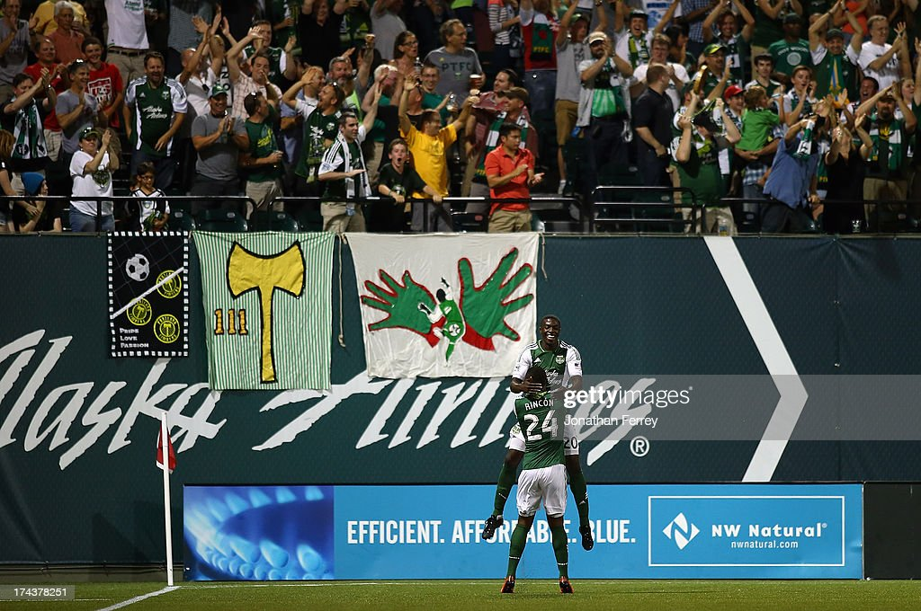 Jose Valencia #20 of the Portland Timbers celebrates with Sebastian Rincon #24 after scoring a goal against Norwich City on July 24, 2013 at Jeld-Wen Field in Portland, Oregon.