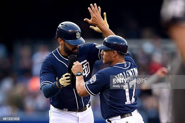 Jose Valentin congratulates Matt Kemp of the San Diego Padres after Kemp hit a double during the game against the Colorado Rockies at Petco Park on...