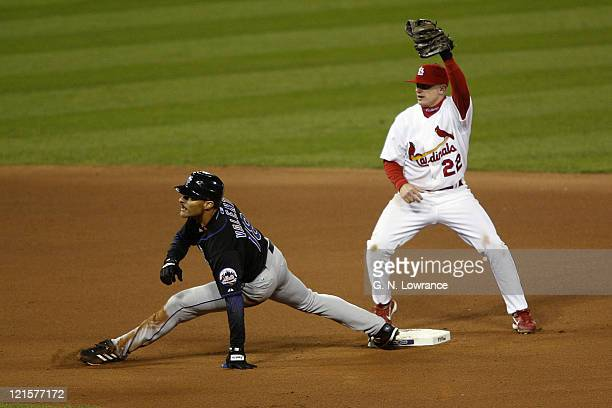 Jose Valentin of the Mets is thrown out at 2nd base on a throw by Preston Wilson during game 3 of the NLCS between the New York Mets and St Louis...