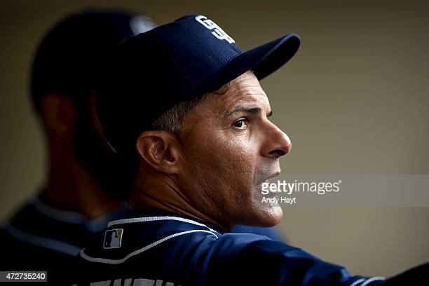 Jose Valentin of the San Diego Padres talks in the dugout during the game against the Colorado Rockies at Petco Park on May 2 2015 in San Diego...