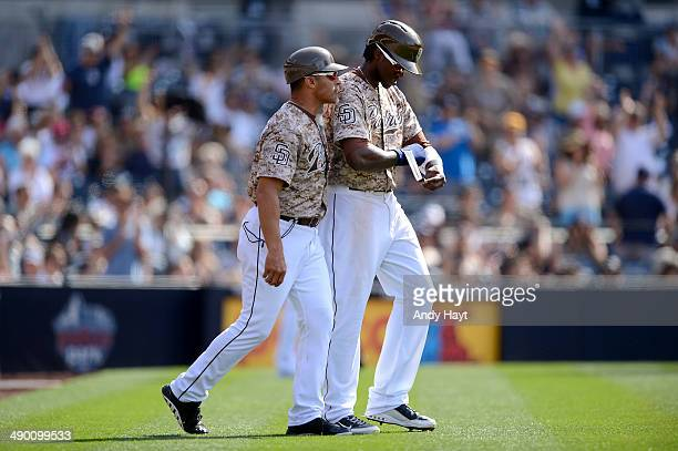 Jose Valentin talks with Cameron Maybin of the San Diego Padres after the reversal of the umpire's call at first base in the ninth inning in the game...