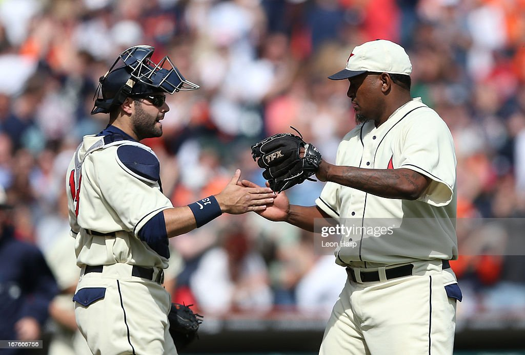 Jose Valverde #46 and Alex Avila #13 of the Detroit Tigers celebrate a win over the Atlanta Braves at Comerica Park on April 27, 2013 in Detroit, Michigan. The Tigers defeated the Braves 7-4.