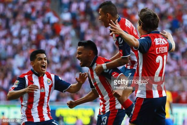 Jose Vazquez of Chivas celebrates with teammates after scoring the second goal of his team during the Final second leg match between Chivas and...