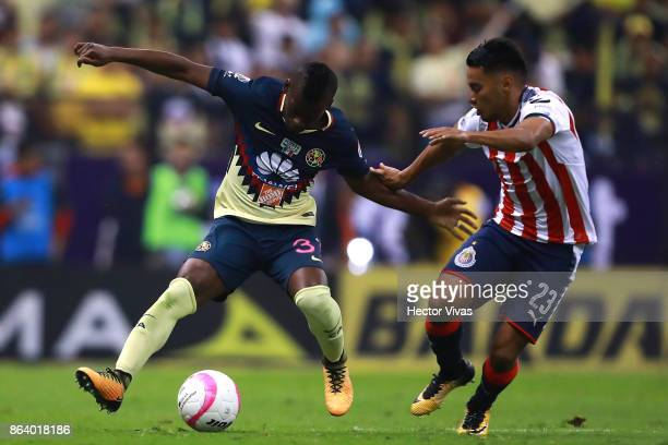 Jose Vazquez of Chivas struggles for the ball with Darwin Quintero of America during the 10th round match between America and Chivas as part of the...