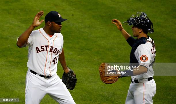 Jose Veras and Jason Castro of the Houston Astros celebrate a 31 victory over the Los Angeles Angels of Anaheim at Minute Maid Park on May 8 2013 in...