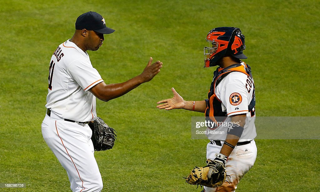 <a gi-track='captionPersonalityLinkClicked' href=/galleries/search?phrase=Jose+Veras&family=editorial&specificpeople=846188 ng-click='$event.stopPropagation()'>Jose Veras</a> #41 celebrates with his catcher <a gi-track='captionPersonalityLinkClicked' href=/galleries/search?phrase=Carlos+Corporan&family=editorial&specificpeople=5716887 ng-click='$event.stopPropagation()'>Carlos Corporan</a> #22 after the Houston Astros defeated the Los Angeles Angels of Anaheim 7-6 at Minute Maid Park on May 7, 2013 in Houston, Texas.