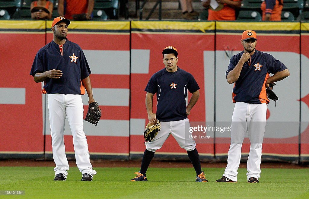 Jose Veras #55, Jose Altuve #27 and Jesus Guzman #14 of the Houston Astros during batting practice before a game against the Texas Rangers at Minute Maid Park on August 9, 2014 in Houston, Texas. Altvue is not in the lineup due to a sore neck.