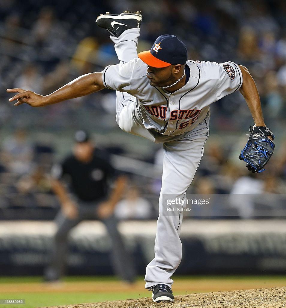 <a gi-track='captionPersonalityLinkClicked' href=/galleries/search?phrase=Jose+Veras&family=editorial&specificpeople=846188 ng-click='$event.stopPropagation()'>Jose Veras</a> #55 of the Houston Astros delivers a pitch against the New York Yankees during the ninth inning of a MLB baseball game at Yankee Stadium on August 20, 2014 in the Bronx borough of New York City. The Astros defeated the Yankees 5-2.