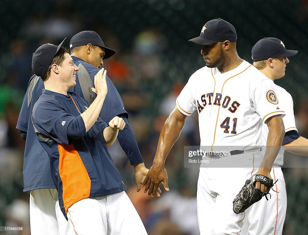 Jose Veras #41 of the Houston Astros high fives with Lucas Harrell #64 of the Houston Astros after the final out as the Houston Astros defeated the Tampa Bay Rays 4-1 at Minute Maid Park on July 3, 2013 in Houston, Texas.