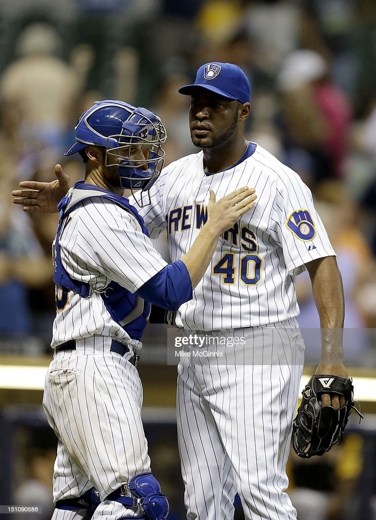 <a gi-track='captionPersonalityLinkClicked' href=/galleries/search?phrase=Jose+Veras&family=editorial&specificpeople=846188 ng-click='$event.stopPropagation()'>Jose Veras</a> #40 of the Milwaukee Brewers celebrates with <a gi-track='captionPersonalityLinkClicked' href=/galleries/search?phrase=Jonathan+Lucroy&family=editorial&specificpeople=5732413 ng-click='$event.stopPropagation()'>Jonathan Lucroy</a> #20 after a 9-3 win over the Pittsburgh Pirates at Miller Park on August 31, 2012 in Milwaukee, Wisconsin.