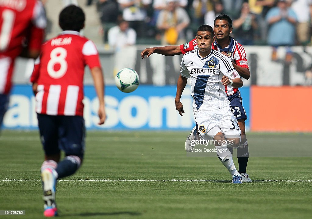 Jose Villarreal #33 of the Los Angeles Galaxy and Joaquin Velasquez #23 of Chivas USA vie for the ball during the MLS match at The Home Depot Center on March 17, 2013 in Carson, California. Chivas USA and the Los Angeles Galaxy played to a 1-1 draw.