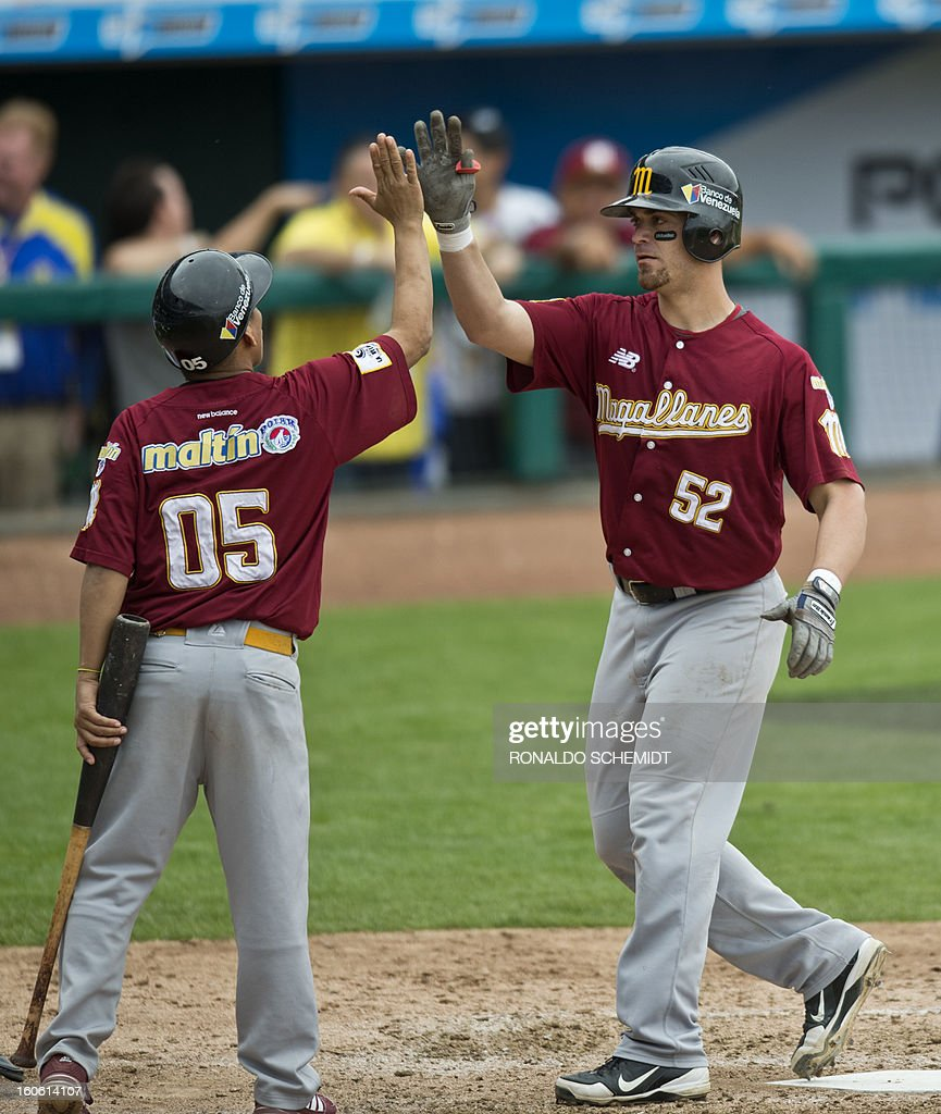Jose Yepez (R) of Magallanes of Venezuela celebrates his home run against Criollos de Cagua of Puerto Rico, during the 2013 Baseball Caribbean Series, on February 3, 2013, in Hermosillo, Sonora State, northern Mexico. AFP PHOTO/Ronaldo Schemidt