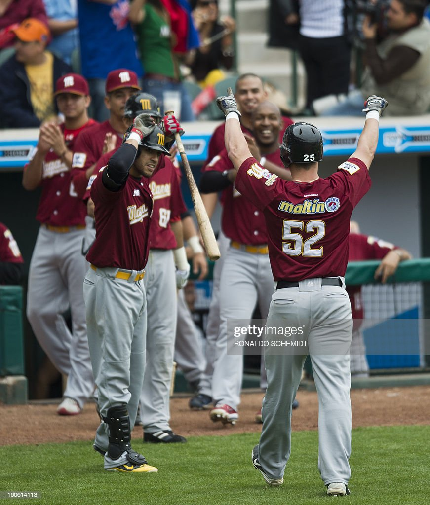 Jose Yepez (#52) of Magallanes of Venezuela celebrates his home run against Criollos de Cagua of Puerto Rico with teammates, during the 2013 Baseball Caribbean Series, on February 3, 2013, in Hermo...