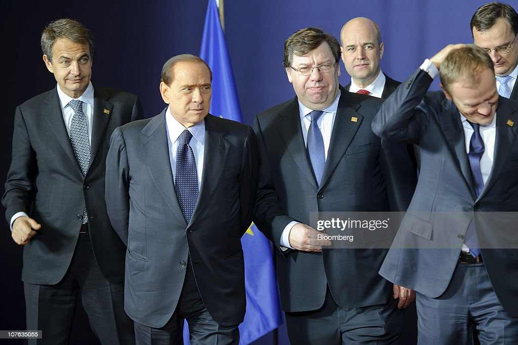 Jose Zapatero, Spain's prime minister, from left, <a gi-track='captionPersonalityLinkClicked' href=/galleries/search?phrase=Silvio+Berlusconi&family=editorial&specificpeople=201842 ng-click='$event.stopPropagation()'>Silvio Berlusconi</a>, Italy's prime minister, Brian Cowen, Ireland's prime minister, Fredrik Reinfeldt, Sweden's prime minister, <a gi-track='captionPersonalityLinkClicked' href=/galleries/search?phrase=Donald+Tusk&family=editorial&specificpeople=870281 ng-click='$event.stopPropagation()'>Donald Tusk</a>, Poland's prime minister, and <a gi-track='captionPersonalityLinkClicked' href=/galleries/search?phrase=Petr+Necas&family=editorial&specificpeople=3014277 ng-click='$event.stopPropagation()'>Petr Necas</a>, prime minister of the Czech Republic, speak as European Union leaders gather for the family photograph during the EU summit at the European Council headquarters in Brussels, Belgium, on Thursday, Dec. 16, 2010. European Union divisions widened over how to contain the debt contagion that threatens the euro, limiting a summit starting today to agreeing on a crisis-management mechanism that takes effect in 2013. Photographer: Jock Fistick/Bloomberg via Getty Images