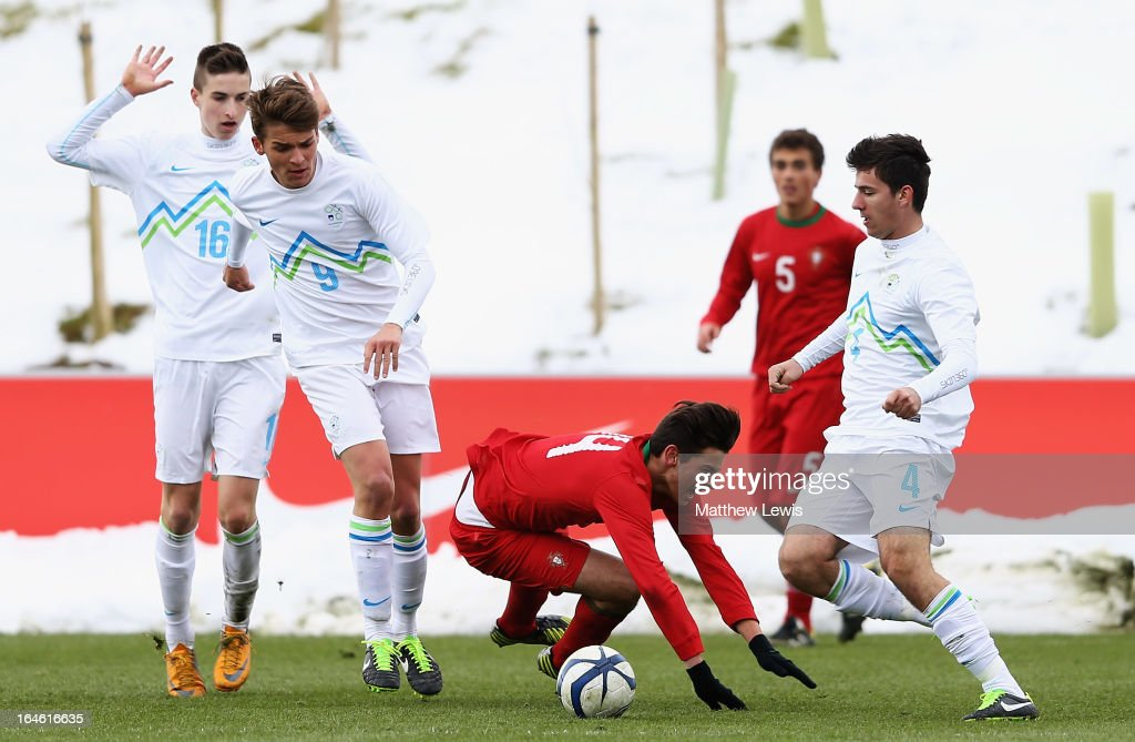 Jose Ze Gomes of Portugal is tackled by Luka Gajic of Slovenia during the UEFA European Under-17 Championship Elite Round match between Slovenia and Portugal at St George's Park on March 25, 2013 in Burton-upon-Trent, England.