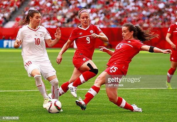 Josee Belanger and Allysha Chapman of Canada and Ramona Bachmann of Switzerland battle for the ball during the FIFA Women's World Cup Canada 2015...