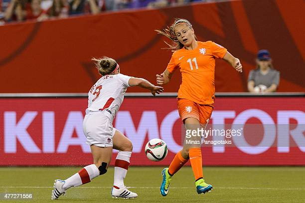 Josee Belanger of Canada and Lieke Martens of the Netherlands battle for the ball during the 2015 FIFA Women's World Cup Group A match at Olympic...
