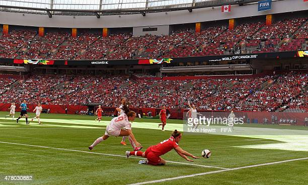 Josee Belanger of Canada is challenged by Lia Waelti of Switzerland in front of a full house during the FIFA Women's World Cup 2015 Round of 16 match...