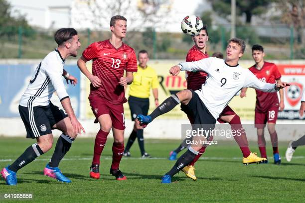 JoseEnrique Rios Alonso and JannFiete Arp of Germany U17 challenges Pedro Ganchas and Vitor Ferreira of Portugal U17 during the U17 Algarve Cup...