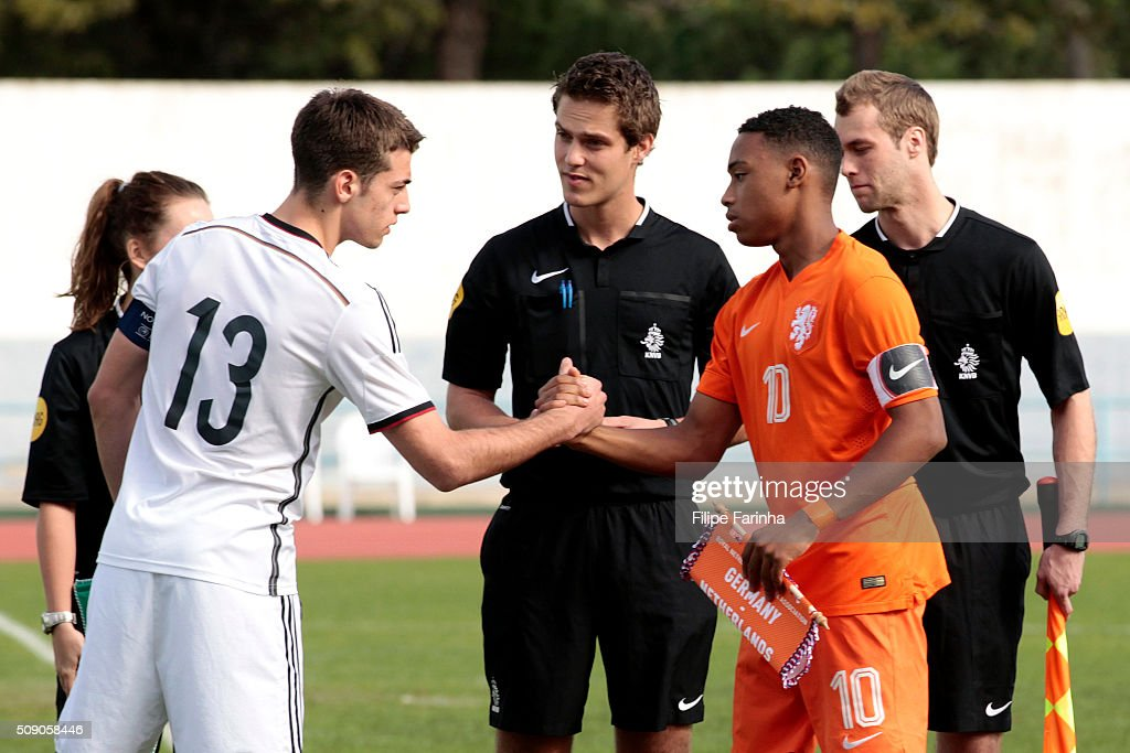 Jose-Enrique Rios Alonso of Germany shakes hands with Juan Familia Castillo of Netherlands during the UEFA Under16 match between U16 Germany v U16 Netherlands on February 8, 2016 in Vila Real de Santo Antonio, Portugal. (Photo by Filipe Farinha/Bongarts/Getty Images