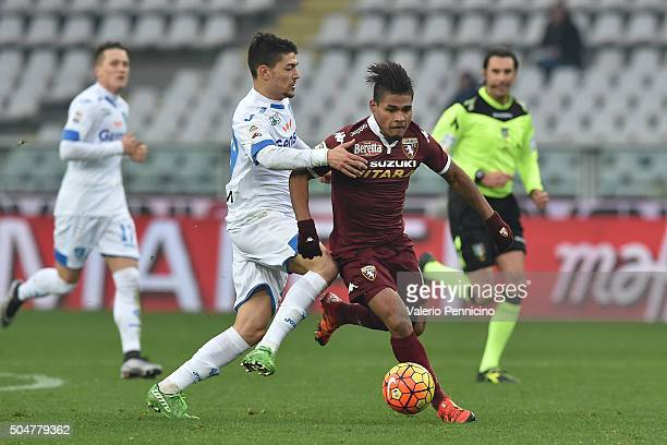 Josef Alexander Martinez of Torino FC is challenged by Federico Barba of Empoli FC during the Serie A match between Torino FC and Empoli FC at Stadio...