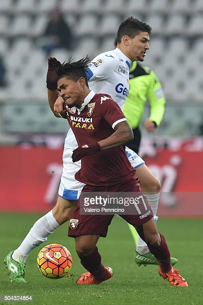 Josef Alexander Martinez of Torino FC is tackled by Federico Barba of Empoli FC during the Serie A match between Torino FC and Empoli FC at Stadio...