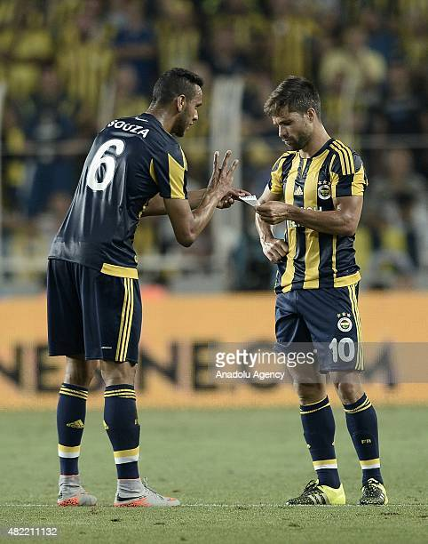 Josef de Souza of Fenerbahce shows the note of Fenerbahce's head coach Vitor Pereira to his teammate Diego Ribas during UEFA Champions League Third...