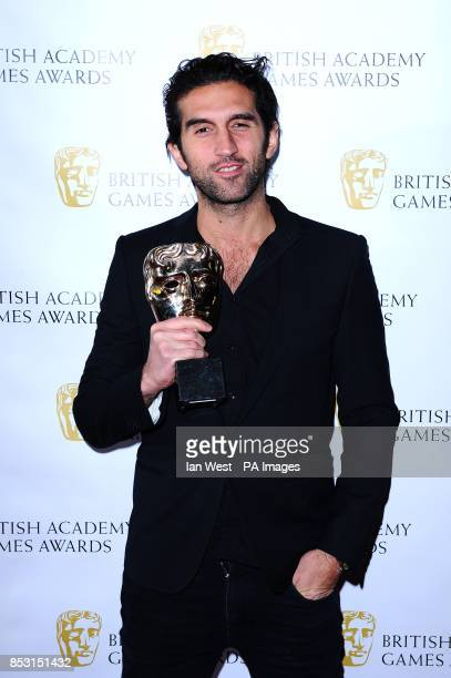 Josef Fares with the Game Innovation award for BrothersA Tale Of Two Sons at the British Academy Games Awards at Tobacco Dock London