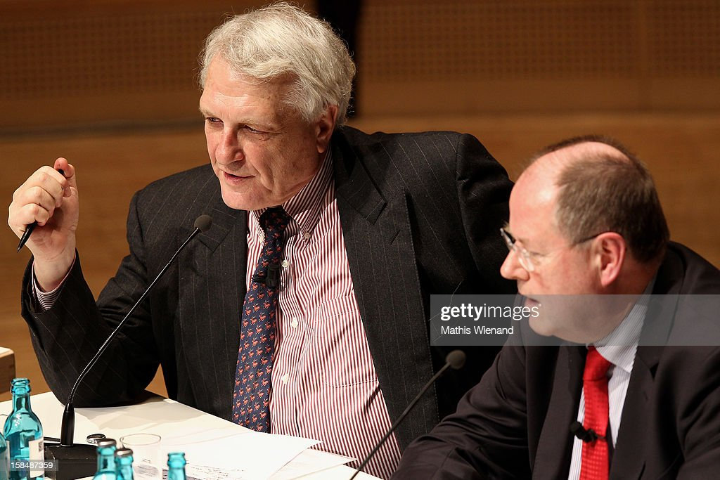 Josef Joffe, editor in chief of German weekly 'Die Zeit' and Chancellor candidate of the German Social Democrats (SPD) <a gi-track='captionPersonalityLinkClicked' href=/galleries/search?phrase=Peer+Steinbrueck&family=editorial&specificpeople=209110 ng-click='$event.stopPropagation()'>Peer Steinbrueck</a> attend a podium discussion at the Ruhr Initiative Circle (Initiativkreis Ruhr) congress on December 17, 2012 in Essen, Germany. German police recently raided the headquarters of Deutsche Bank and are investigating Fitschen and 24 other Deutsche Bank employees on suspicion of money laundering and tax evasion related to the trading of carbon emissions certificates.