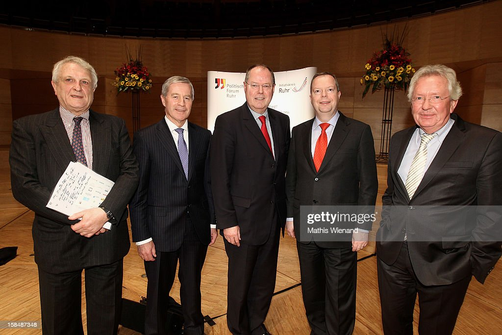 Josef Joffe, editor in chief of German weekly 'Die Zeit', Deutsche Bank co-Chairman <a gi-track='captionPersonalityLinkClicked' href=/galleries/search?phrase=Juergen+Fitschen&family=editorial&specificpeople=3093173 ng-click='$event.stopPropagation()'>Juergen Fitschen</a>, Chancellor candidate of the German Social Democrats (SPD) <a gi-track='captionPersonalityLinkClicked' href=/galleries/search?phrase=Peer+Steinbrueck&family=editorial&specificpeople=209110 ng-click='$event.stopPropagation()'>Peer Steinbrueck</a>, Peter Terium, incoming chief executive officer of RWE AG and Bodo Hombach, Manager of the WAZ-Group attend a podium discussion at the Ruhr Initiative Circle (Initiativkreis Ruhr) congress on December 17, 2012 in Essen, Germany. German police recently raided the headquarters of Deutsche Bank and are investigating Fitschen and 24 other Deutsche Bank employees on suspicion of money laundering and tax evasion related to the trading of carbon emissions certificates.