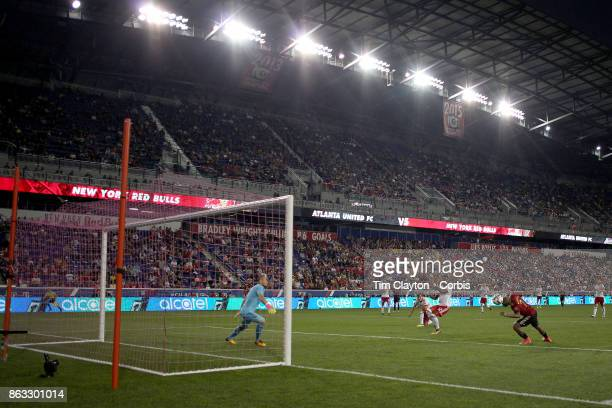 Josef Martinez of Atlanta United just fails to get his head to the ball as goalkeeper Luis Robles of New York Red Bulls prepare to react during the...