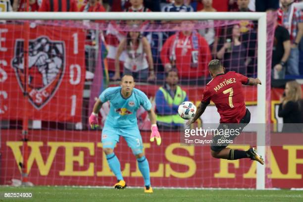 Josef Martinez of Atlanta United shoots watched by Luis Robles of New York Red Bulls during the New York Red Bulls Vs Atlanta United FC MLS regular...