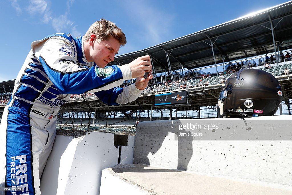 <a gi-track='captionPersonalityLinkClicked' href=/galleries/search?phrase=Josef+Newgarden&family=editorial&specificpeople=8836434 ng-click='$event.stopPropagation()'>Josef Newgarden</a> of the United States, driver of the #21 Ed Carpenter Racing Dallara Chevrolet, takes a picture of his helmet during Carb Day ahead of the 100th running of the Indianapolis 500 at Indianapolis Motorspeedway on May 27, 2016 in Indianapolis, Indiana.